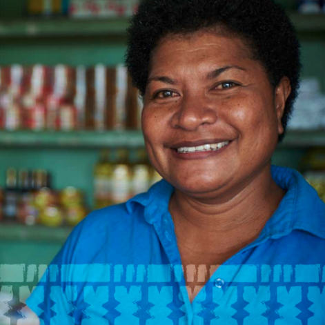 The image is from the cover of the report; it shows a woman smiling with an out-of focus shelf with canned goods in the background.